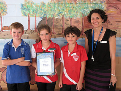 Merinda State School students Yadi Dodd, Gabe Eaton and Sean Ryan, and teacher Helena Tully proudly accept the Ripples of Change grant. They will use the $500 funding from the Great Barrier Reef Marine Park Authority to develop a vegetable garden and create a worm farm to nourish the vegetables.