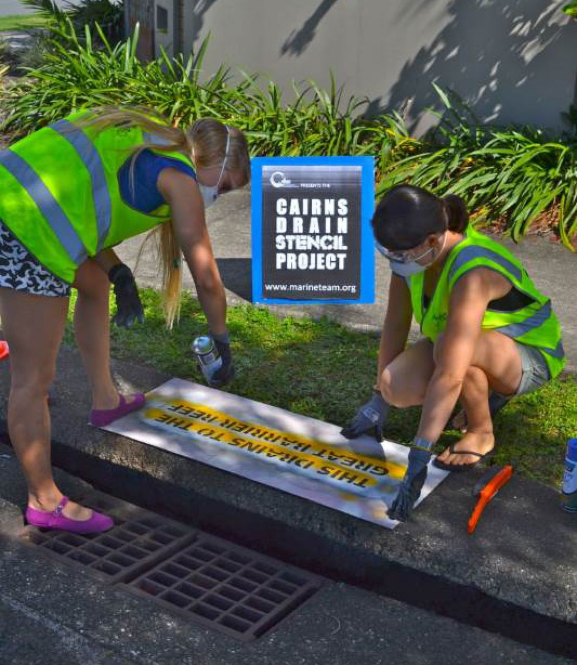 Cairns drain stencil project, alerting people that 'This drains to the Great Barrier Reef'
