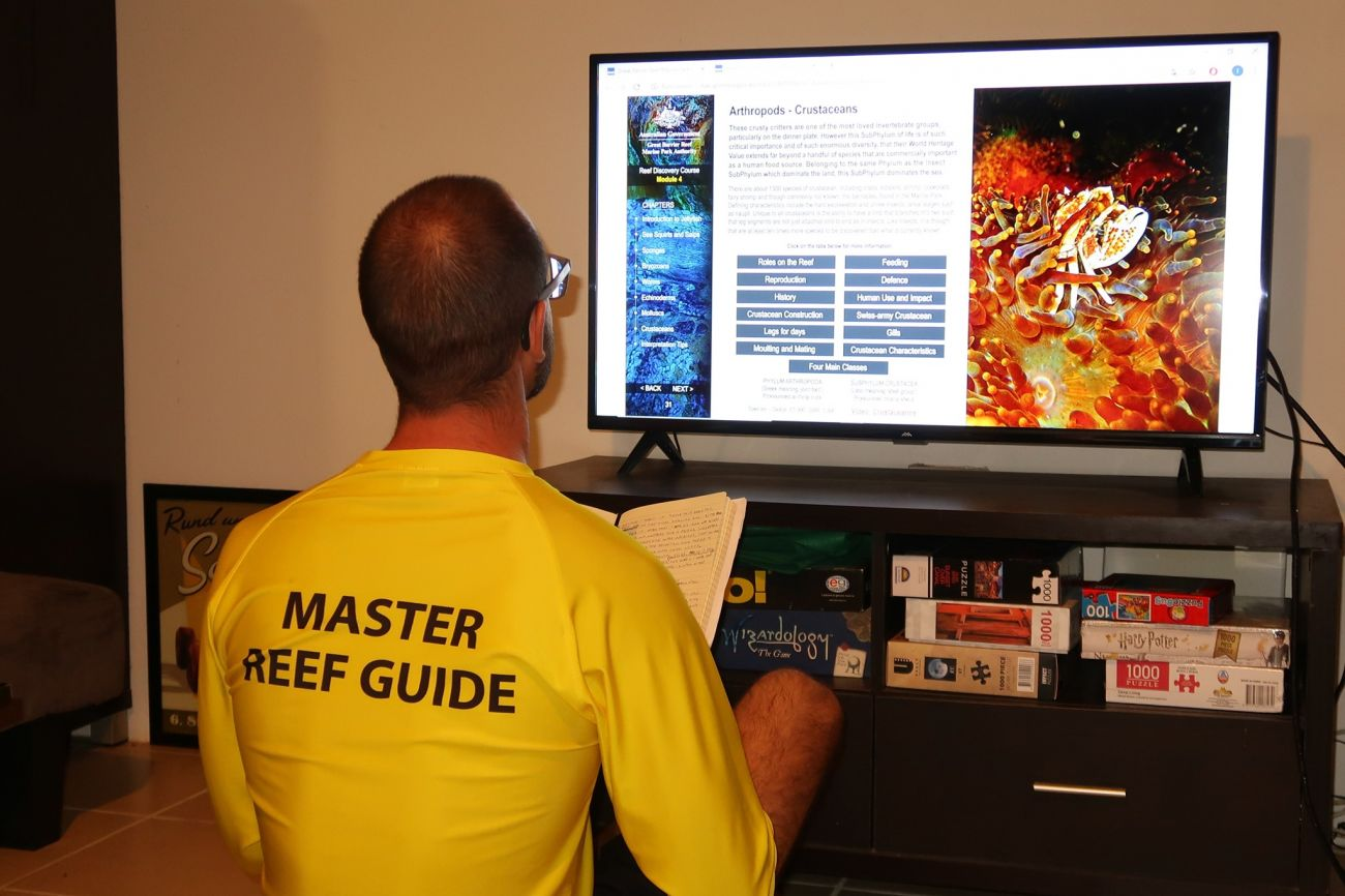 Master Reef Guide Paolo Bonvini studying the Reef Discovery Course