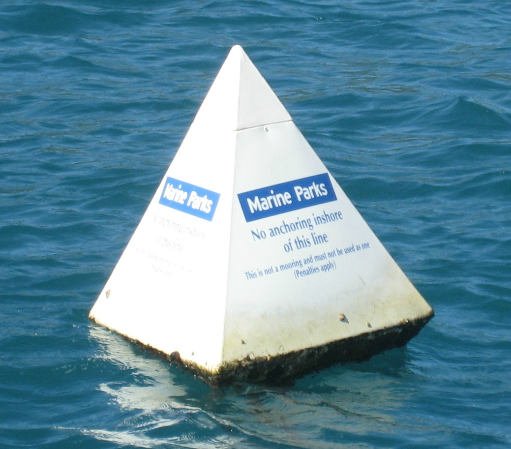 Reef Protection Areas are generally marked with white pyramid-shaped buoys.