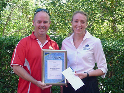 Mt Gravatt State High School teacher Andrew Walsh accepts the Great Barrier Reef Marine Park Authority's Water Warriors annual Award from Acting Reef Guardian Schools Program Manager, Carolyn Luder. The school will be using the $1000 funding to continue implementing Reef Guardian projects including rehabilitating local bushland and cleaning up local waterways.