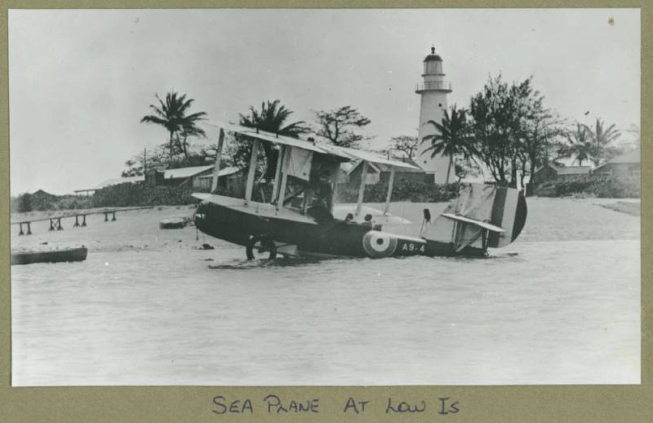 Low Isles aircraft and Lighthouse keeper © Frank Carter